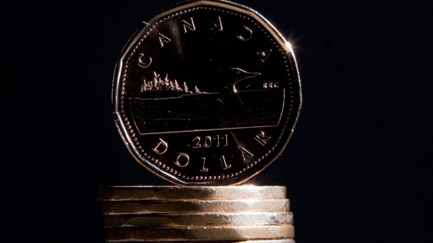 Canadian dollars (loonies) are pictured in Vancouver, B.C. file photo. (The Canadian Press/Jonathan Hayward)