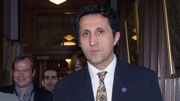 Quebec Solidaire leader Amir Khadir walks to a news conference where they announced a common front on the Caisse de Depot, Friday, May 29, 2009 at the Quebec legislature. (Jacques Boissinot / THE CANADIAN PRESS)
