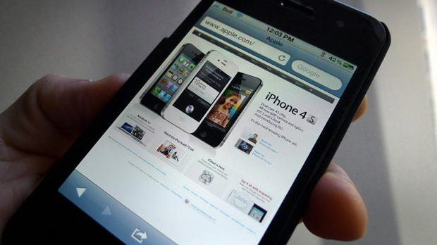 A web page is displayed on an Apple iPhone. (Graeme Roy / THE CANADIAN PRESS)