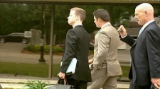 Waterloo Regional Police Service Const. Andrew Robson , centre, is facing a trial.