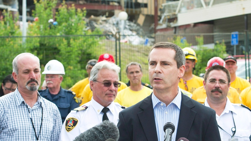 Ontario Premier Dalton McGuinty, centre, speaks to the community at the Algo Centre Mall in Elliot Lake, Ont., on Wednesday, June 27, 2012. (Nathan Denette / THE CANADIAN PRESS)