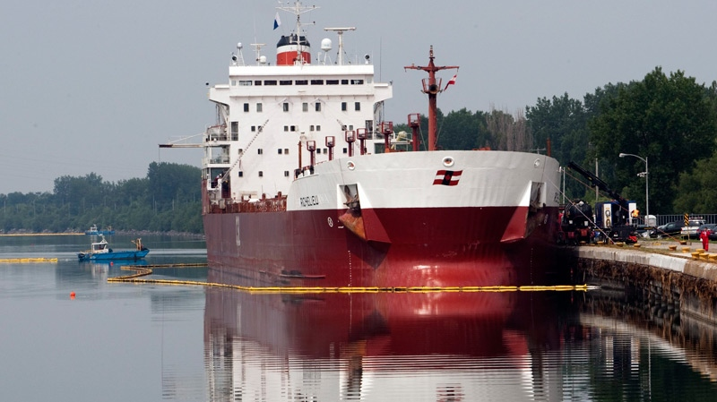 The Canada Steamship Line freighter Richelieu is surrounded by buoys to contain a fuel spill after it ran aground in the St. Lawrence Seaway, Cote Ste-Catherine, on the south shore of Montreal, Tuesday, July 13, 2010. (Ryan Remiorz / THE CANADIAN PRESS)