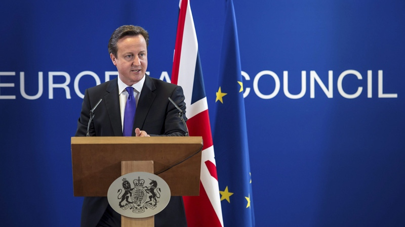 British Prime Minister David Cameron gestures while speaking during a media conference at an EU Summit in Brussels on Friday, June 29, 2012. (AP Photo/Geert Vanden Wijngaert)