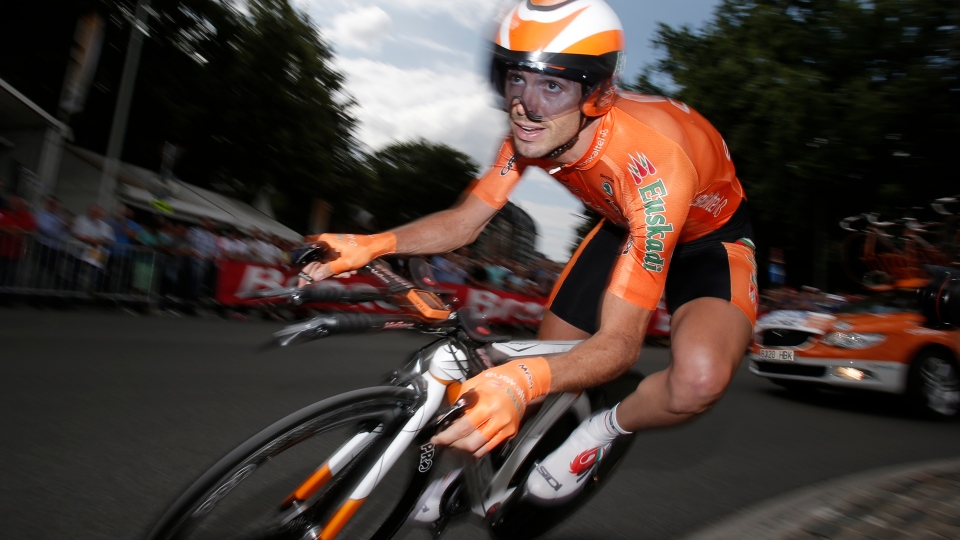 Samuel Sanchez of Spain corners a roundabout in the prologue of the Tour de France cycling race, an individual time trial over 6,4 kilometers (4 miles) with start and finish in Liege, Belgium, Saturday June 30 2012. (AP Photo/Christophe Ena)