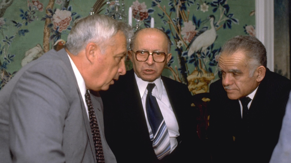 In this Sept. 9, 1981, file photo., Israeli Defense Minister Ariel Sharon, left, meets with then Prime Minister Menachem Begin, center, and former Foreign Minister Yitzhak Shamir  (AP Photo/Government Press Office)