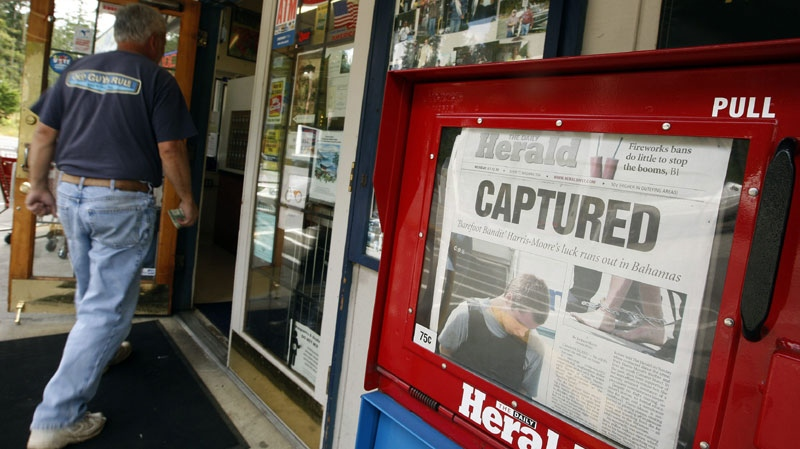 "The front page of The Daily Herald, featuring the story of Colton Harris-Moore, also known as the ""Barefoot Bandit,"" is seen in Camano Island, Wash., Monday, July 12, 2010. (AP Photo/Kevin P. Casey)"