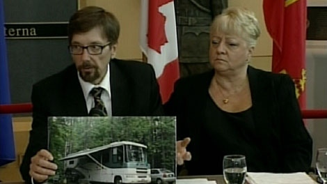 The son of Marie and Lyle McCann, Bret, holds up a picture of his missing parent's motorhome at a press conference in Edmonton on July 13, 2010. (CTV)