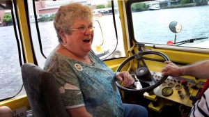 Retired bus monitor Karen Klein, of Greece, N.Y., sits at the controls of a duck boat, an amphibious tourism vehicle, while floating in the Charles River, in Boston, Thursday, June 28, 2012. (AP / Steven Senne)