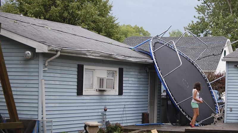 In this photo taken Friday, June 29, 2012 shows a trampoline smashed into the side of the garage in Lima, Ohio. (AP Photo/The Lima News, Gretchen White)