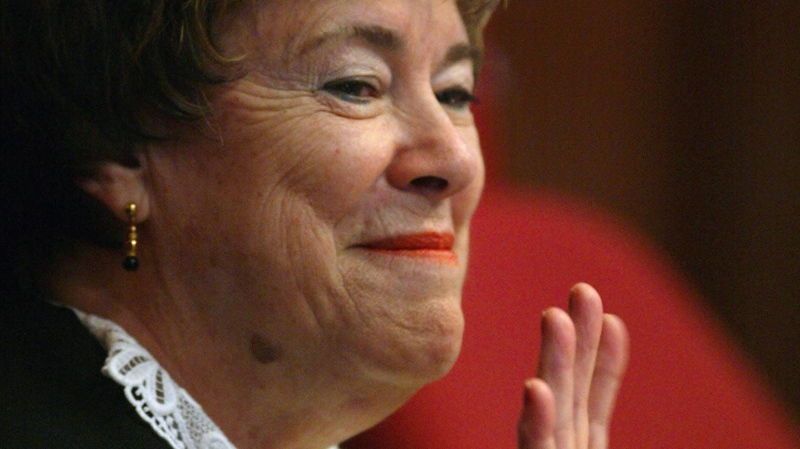 Supreme Court Justice Claire L'Heureux-Dube waves upon her retiring from the court, in Ottawa, June 10, 2002. (Tom Hanson / THE CANADIAN PRESS)