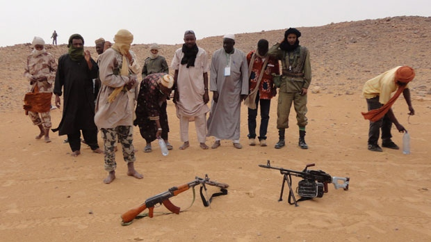 Islamist rebels from the Ansar Dine faction prepare to pray in the desert just outside Gao, Mali, May 16, 2012. (AP / Diakaridia Dembele)