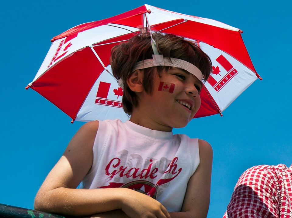 An unidentified youth waches a Canada Day parade in Halifax on Sunday, July 1, 2012. (Andrew Vaughan / THE CANADIAN PRESS)