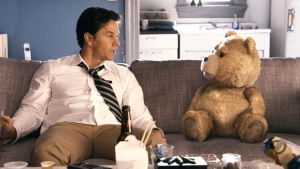 This film image released by Universal Pictures shows Mark Wahlberg, left with the character Ted, voiced by Seth MacFarlane in a scene from 'Ted.' (AP / Universal Pictures)