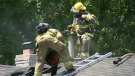 Firefighters battle a blaze on Manatoulin Cres. in Kitchener
