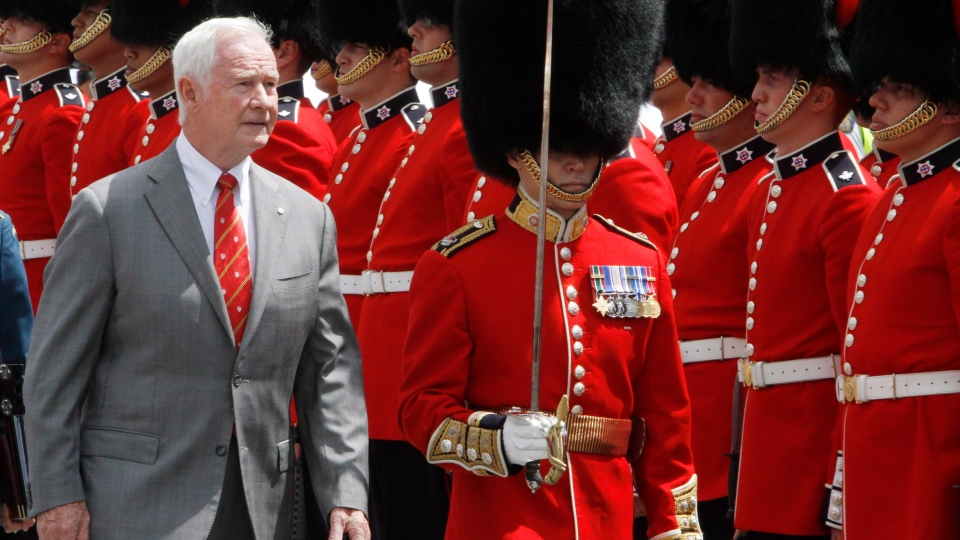 FILE - Gov. Gen. David Johnston inspects the Governor General's Honor Guard on Parliament Hill, as he takes part in the Canada Day celebrations in Ottawa, Sunday July 1, 2012. (Fred Chartrand / THE CANADIAN PRESS)