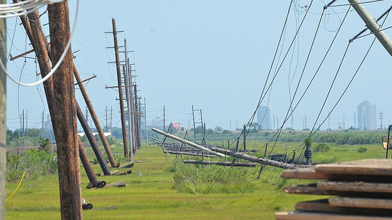 Downed and leaning powerlines on the water works access road across from the Delilah Road ramp connecting to Route 30 eastbound to Atlantic City, N.J., Sunday, July 1, 2012. (AP / The Press of Atlantic City, Ben Fogletto)
