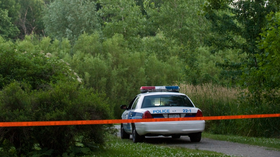 A police vehicle is seen at a Montreal park where police carried out a search on Sunday, July 1, 2012. (Graham Hughes / THE CANADIAN PRESS)