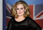 Performer Adele arrives for the Brit Awards 2012 at the O2 Arena in London, Feb. 21, 2012. (AP / Jonathan Short)