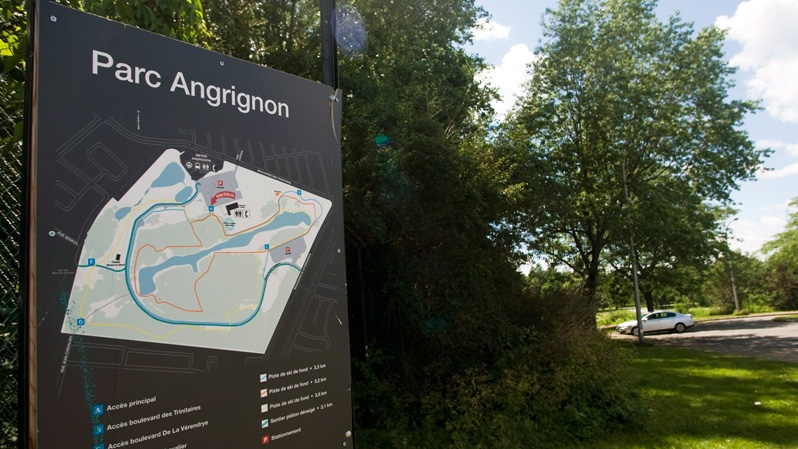 A sign for Parc Angrignon, where police carried out a search after receiving information linked to the Luka Rocco Magnotta case, is shown in Montreal, Monday, July 2, 2012. (Graham Hughes / THE CANADIAN PRESS)