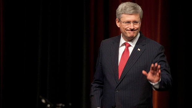 Prime Minister Stephen Harper waves to people after speaking at the opening of the World French Language Forum  in Quebec City, Monday, July 2, 2012. (Jacques Boissinot / The Canadian Press)