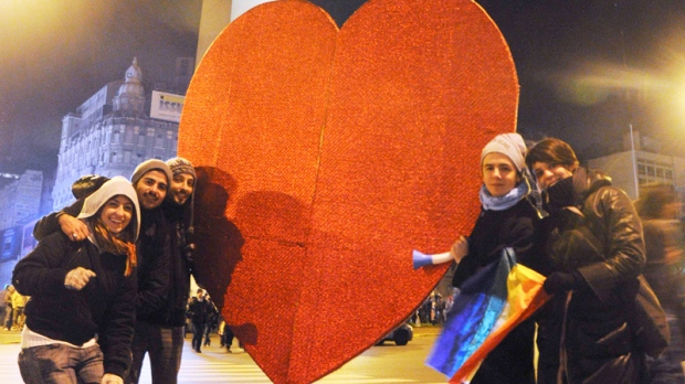 Supporters of same sex marriage hold a heart as they pose in front of Buenos Aires' obelisk early Thursday July 15, 2010 after Argentina legalized same-sex marriage. (AP / Rolando Andrade Stracuzzi)