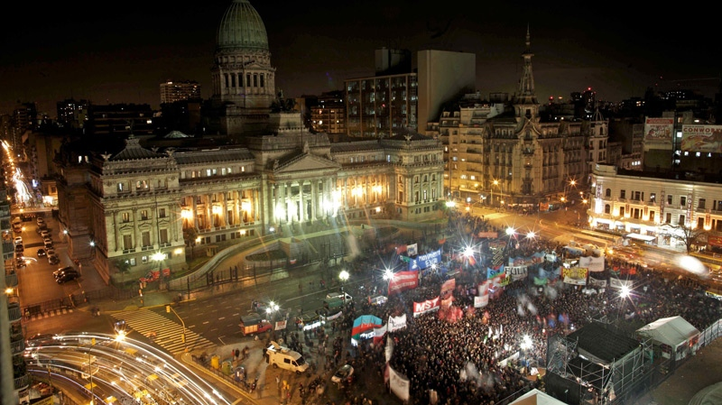 Demonstrators gather outside Argentina's congress during a rally to support a proposal to legalize same-sex marriage in Buenos Aires, Wednesday, July 14, 2010. (AP / Natacha Pisarenko)