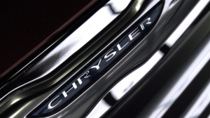 A Chrysler logo emblem is seen on the grill of a 2012 Chrysler 200.