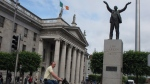 The General Post Office and the statue of trade-union icon James Larkin are seen on Dublin's central boulevard, O'Connell Street, on Friday, June 29, 2012. (AP Photo/Shawn Pogatchnik)