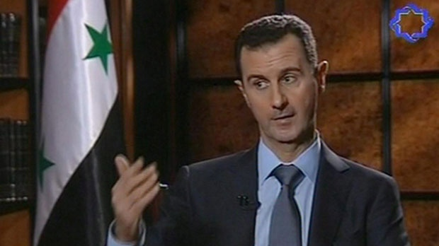 Syria's president Bashar Assad speaks during an interview in Tehran, Iran, on Thursday, June 28, 2012. (IRIB TV via APTN)