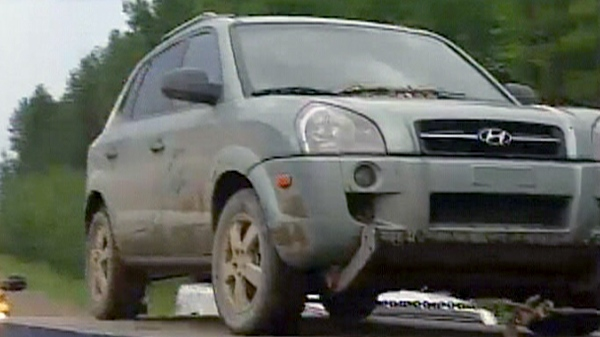 McCann's SUV is seen on a tow truck after being found in Edmonton on Friday, July 16, 2010.