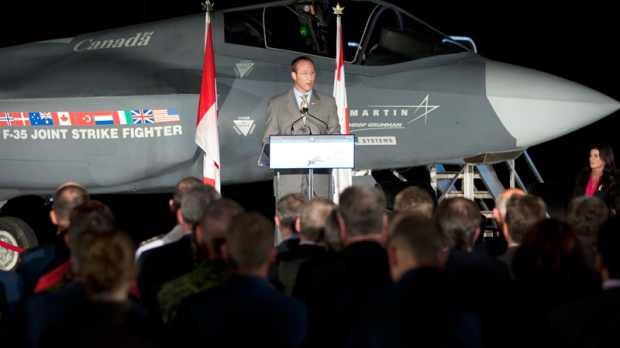 Minister of National Defence and Minister for the Atlantic Gateway Peter MacKay makes an announcement infront of a F-35 Joint Strike Fighter in Ottawa, Friday July 16, 2010. (Adrian Wyld / THE CANADIAN PRESS)