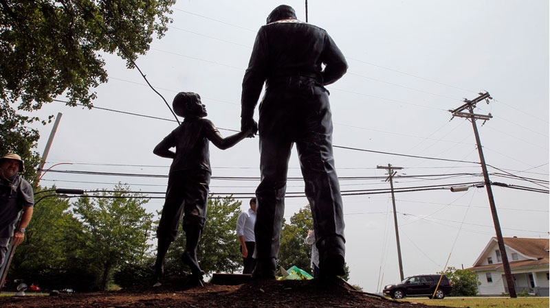 A statue of Andy and Opie Taylor is shown outside the Andy Griffith Playhouse in Mount Airy, N.C., Tuesday, July 3, 2012. (AP / Gerry Broome)
