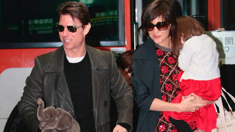 Tom Cruise, left, and Katie Holmes with their daughter Suri arrive in Tokyo on March 8, 2009. (AP /Itsuo Inouye)