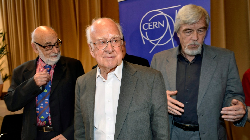 Belgian physicist Francois Englert, left, Rolf Heuer, right, Director General of CERN, and British physicist Peter Higgs, centre, leave after the answers journalist's question at the European Organization for Nuclear Research in Meyrin near Geneva, Switzerland, Wednesday, July 4, 2012. (AP / Keystone / Martial Trezzini)