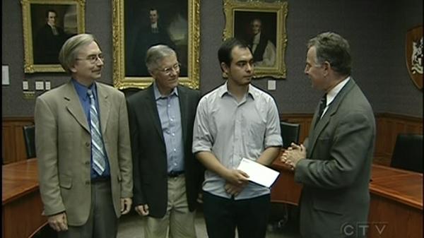 Bill Haugland, Andreas Zambrono, and Joe Singerman talk after Zambrono receives a bursary in Hugh Haugland's name (July 16. 2010)