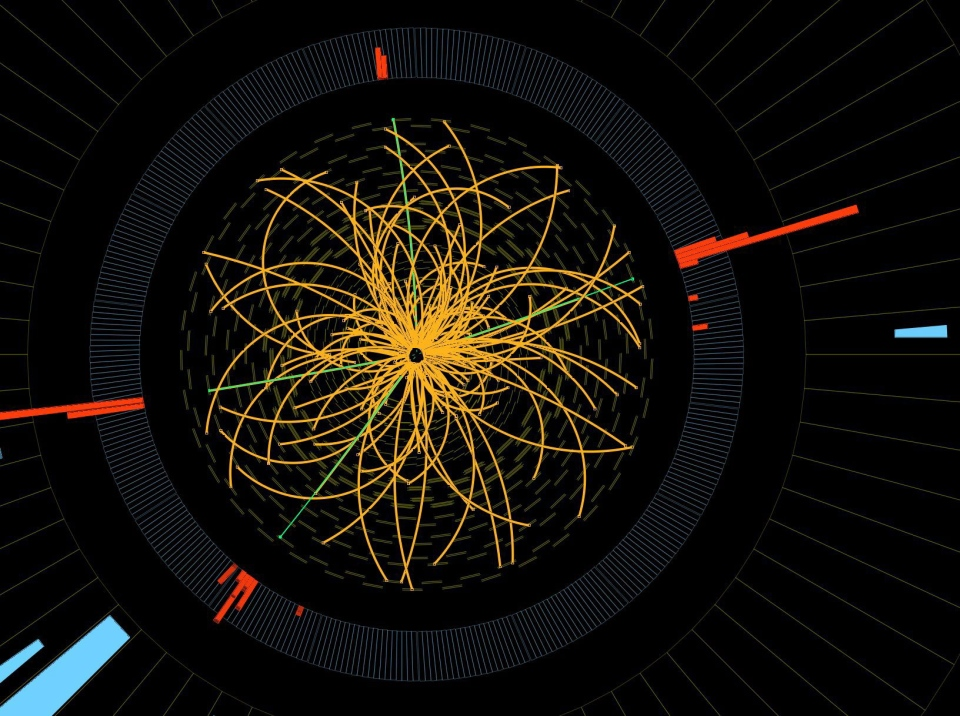 This image provide by CERN shows a real CMS proton-proton collision in which 4 high energy electrons (green lines and red towers) are observed in a 2011 event.