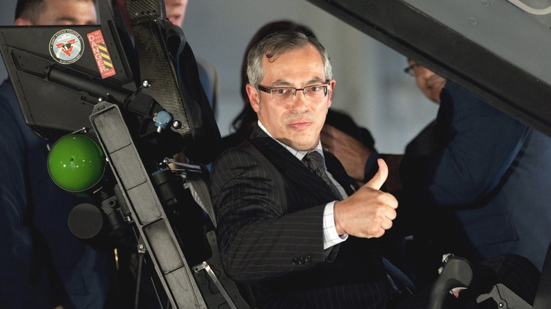Minister of Industry Tony Clement gives the thumbs up as he sits in the cockpit of the F-35 Joint Strike Fighter following an announcement in Ottawa, Friday July 16, 2010. (Adrian Wyld / THE CANADIAN PRESS)
