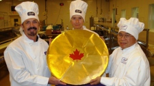 It took three chocolatiers more than eight hours to create the 25-pound chocolate coin in this undated photo. (Bill Chung/Science World)