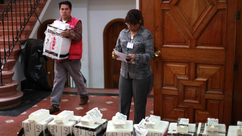 Ballot boxes are brought to an electoral institute district council to be computed in Mexico City, Wednesday, July 4, 2012. (AP / Dario Lopez-Mills)