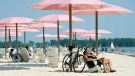 People take in the sun at Sugar Beach in Toronto on Wednesday, July 4, 2012. (Nathan Denette / THE CANADIAN PRESS)
