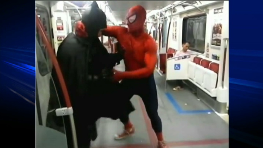 Batman and Spiderman wrestle after coincidentally meeting on Toronto subway