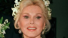 """Zsa Zsa Gabor is shown Los Angeles, in an Aug. 15, 1986 file photo. Zsa Zsa Gabor is scheduled to have surgery Tuesday, Sept. 17, 2007 for """"severe infection in her legs,"""" her publicist said. Gabor's publicist says the 93-year-old actress has been rushed to a hospital Saturday July 17, 2010 after falling out of bed and breaking several bones. The actress is partially paralyzed from a 2002 car accident, which forced her to use a wheelchair. She also reportedly had a stroke in 2005. (AP Photo/File)"""