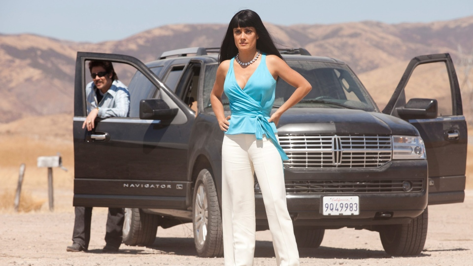 Benicio Del Toro, left, and Salma Hayek in Universal Pictures Canada's 'Savages.'
