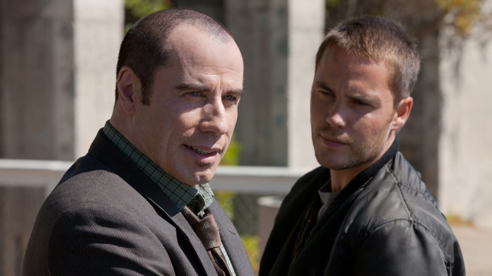John Travolta , left, and Taylor Kitsch in Universal Pictures Canada's 'Savages.'