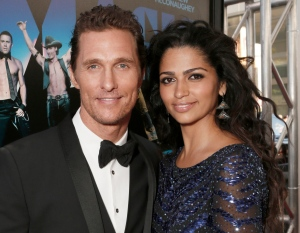 "Matthew McConaughey and his wife Camila Alves attending the premiere of ""Magic Mike"" at Regal Cinemas L.A. Live in Los Angeles. (AP / Todd Williamson)"