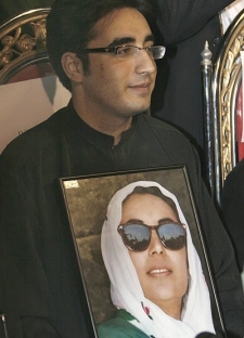 Bilawal Zardari, son of slain former prime minister of Pakistan Benazir Bhutto sits in a news conference holding his mother picture after he has been nominated Chairman of Bhutto's People's party on Sunday, Dec. 30, 2007. (AP / Shakil Adil)
