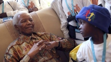 In this photo supplied by the Nelson Mandela Foundation, former South African president Nelson Mandela is surrounded by children at his home in Johannesburg Saturday July 17, 2010. (AP / Debbie Yazbek-Nelson Mandela Foundation)