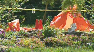 The scene where a man identified as Corey Lewis was shot and killed by an RCMP officer in Okotoks, Alta. is shown on Sunday, July 18, 2010.