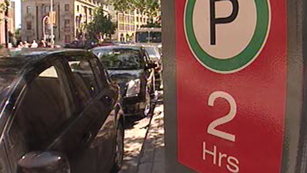 A new report recommends doubling the cost of on-street parking in downtown Winnipeg.