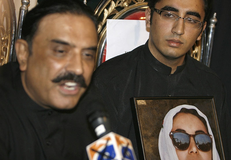 Asif Ali Zardari, left, husband of slain former prime minister of Pakistan Benazir Bhutto addresses a news conference with his son Bilawal Zardari as Bilawal was nominated Chairman of Bhutto's People's party in Naudero near Larkana, Pakistan on Sunday, Dec. 30, 2007. (AP / Shakil Adil)